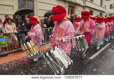 People take part in parade at Basel Carnival in Basel, Switzerland.
