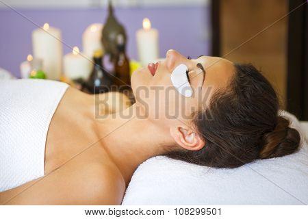 Beautiful Woman With Facial Eye Patch At Beauty Salon