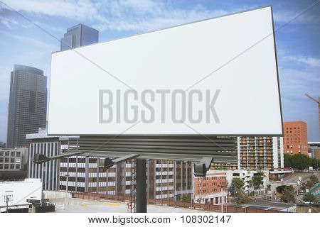 Blank White Billboard On A Background Of Buildings, Mock Up