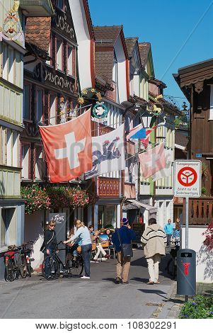 Tourists walk by the street in Appenzell, Switzerland.