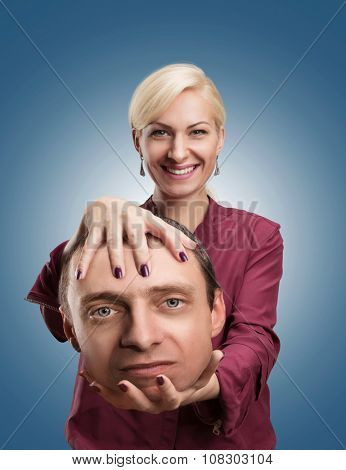 Happy analyst with client's head in her hand