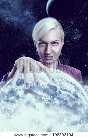 Mystic fortune teller woman holding a planet ball in the night