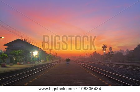 Railway Station At Twilight Time