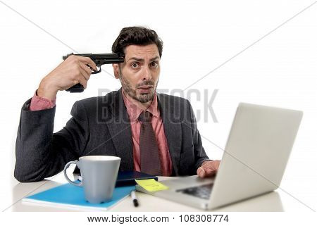Businessman At Office Working On Computer Laptop Pointing Gun To Tempo In Suicide Gesture
