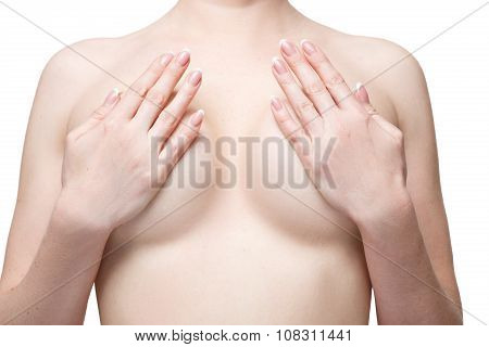 Examining breasts. Close-up of young shirtless woman examining her breasts while. Isolated white bac