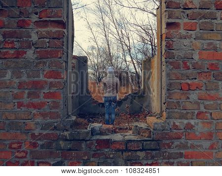girl in a white hat in an abandoned place