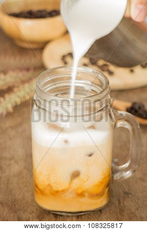 Milk Pouring For Fresh Iced Coffee