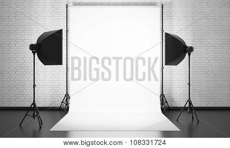 Photo Studio Equipment On A Brick Wall Background. 3D.