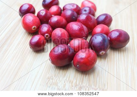 Fresh Cranberries On Wood Background