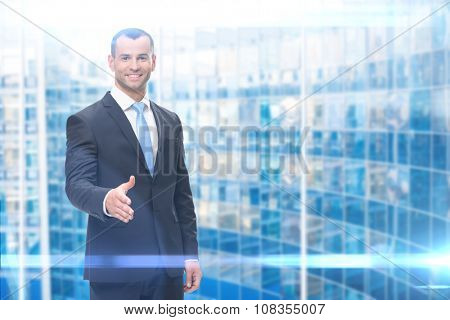 Portrait of business man handshake gesturing, blue background. Concept of leadership and success