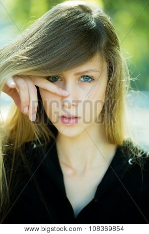 Girl With Finger On Nose