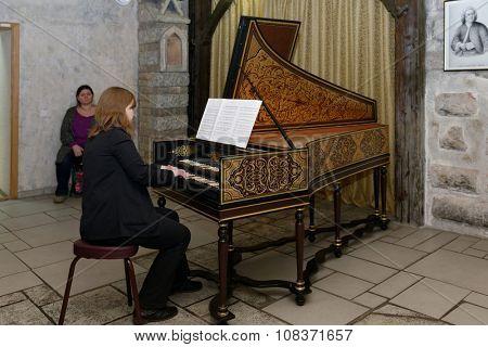 ST. PETERSBURG, RUSSIA - NOVEMBER 14, 2015: Irina Gorokhova plays the harpsichord during the meeting