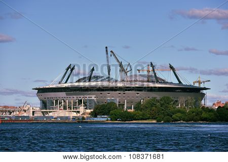 ST. PETERSBURG, RUSSIA - AUGUST 15, 2015: Construction of the stadium Zenit-Arena in the West side of Krestovsky island. The planned capacity of new arena is 68,000 spectators