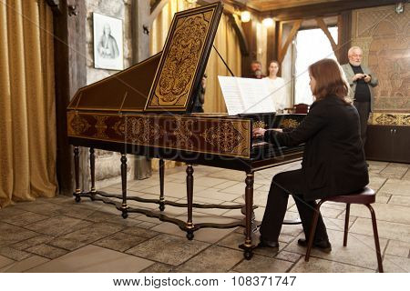 ST. PETERSBURG, RUSSIA - NOVEMBER 14, 2015: Irina Gorokhova plays the harpsichord during the meeting Bell and Carillon Art in Russia at the department of organ, harpsichord, and carillon of SPbSU