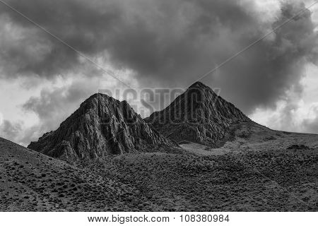 B&W of two mountain peaks.