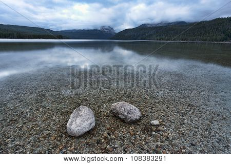 Two Rocks In The Shallow Lake.
