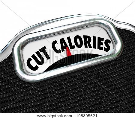 Cut Calories words on a scale display to illustrate dieting to eat less and lose weight