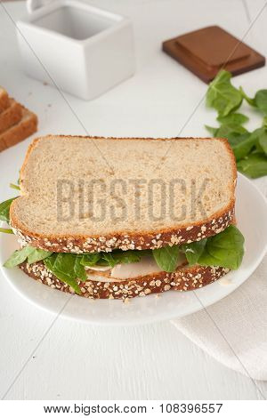 sandwich with mayonaisse, turkey, cheese and fresh spinach