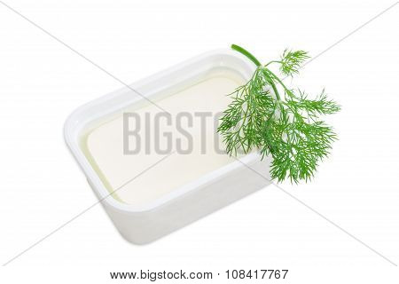 Container Of Feta Cheese And A Branch Of A Dill