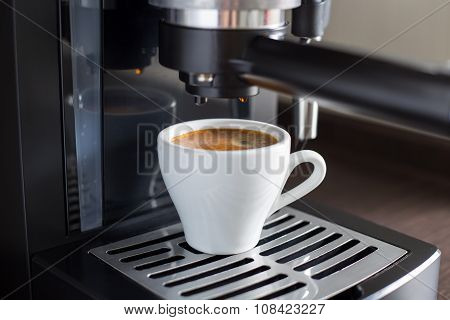 Brewing tasty espresso with coffee machine. Preparing coffee at home or work poster