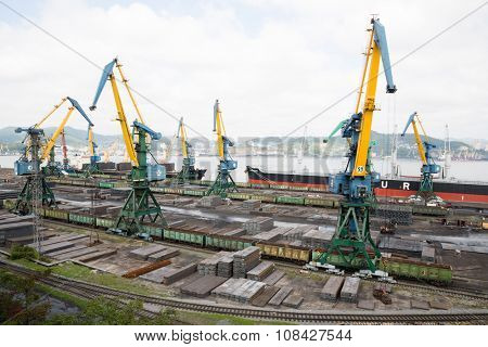 NAKHODKA, RUSSIA - CIRCA SEPTEMBER, 2015: Loading metal in cargo ships at the port of Nakhodka. It is the largest port in Russia, main export goods in port of Nakhodka are coal, oil, wood and metals