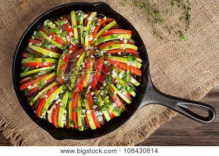 Traditional raw vegetable ratatouille in cast iron frying pan preparation recipe heathy organic vege