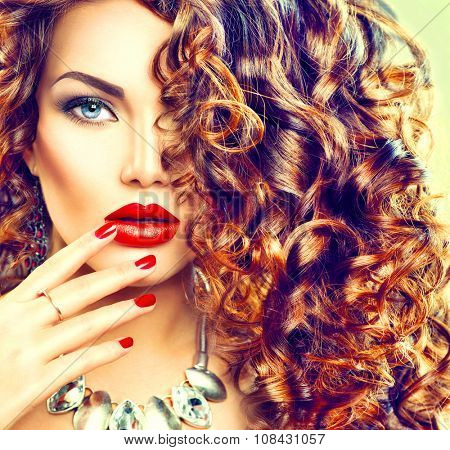 Beauty young brunette woman with curly hair, perfect make up and manicure. Permed hair. Glamour lady, Beauty Girl. Beautiful Woman Portrait. Wavy Hair