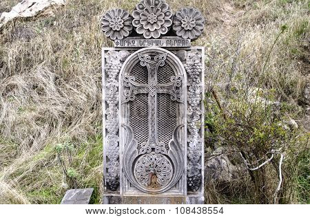 The stone slab with the cross and tap forwater