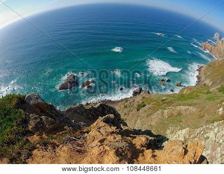 Fisheye view of rocky sea coast at Cabo Da Roca Portugal