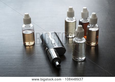 E-cigarettes With Lots Of Different Re-fill Bottles
