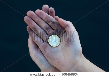 Young Homeless Boy Holds One Euro Coin