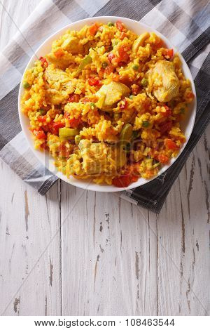 Hispanic Cuisine: Arroz Con Pollo Close Up In A Bowl. Vertical Top View