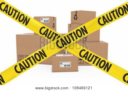 Suspicious Parcels Concept - Stack Of Cardboard Boxes Behind Caution Tape Cross