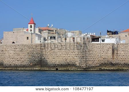 wall of an old fortress in Acre. Israel