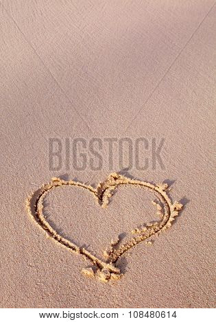 Heart drawn on sand.
