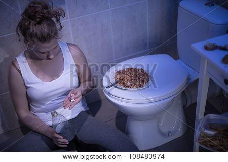 Girl Taking Pills