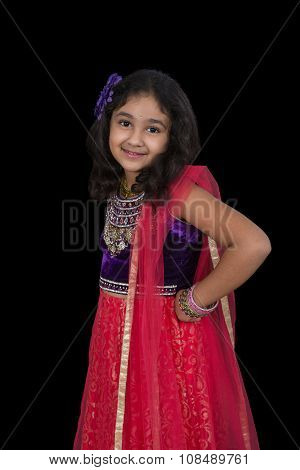 Portrait Of A Little Girl In Indian Dance Pose, Isolated, Black