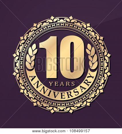 Vintage Anniversary 10 Years Round Emblem. Retro Styled Vector Background In Gold Tones On Dark Blue