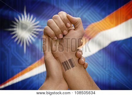 Barcode Id Number On Wrist Of Dark Skinned Person And National Flag On Background - Marshall Islands
