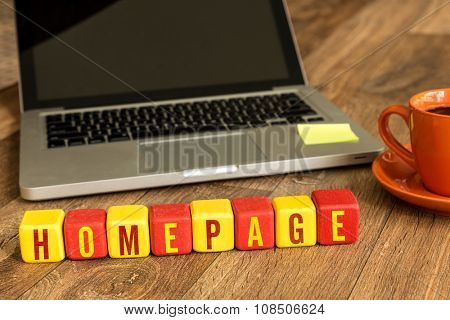 Homepage written on a wooden cube in a office desk