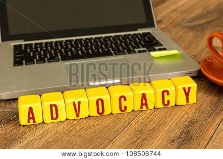Advocacy written on a wooden cube in a office desk
