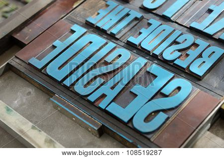 typeset letter blocks with blue paint