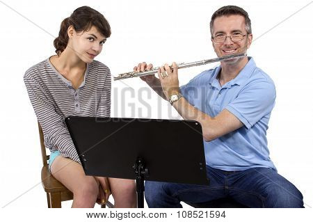 Music instructor teaching female student how to play the flute poster