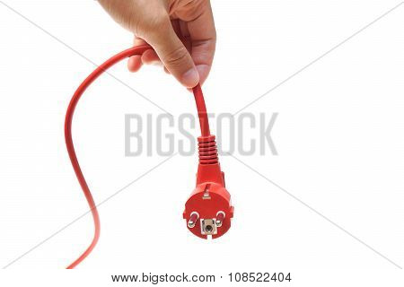 hand unplug a red plug / Save energy concept