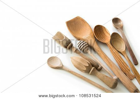 set of wooden kitchen spoons and other items on white background with textspace