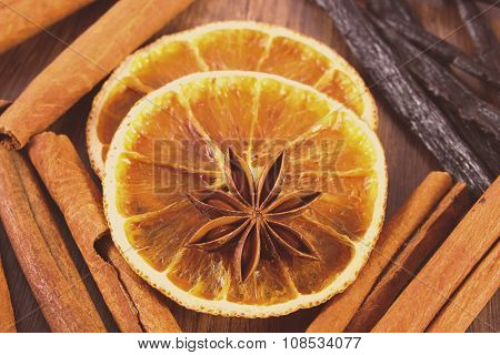 Vintage Photo, Star Anise, Fragrant Vanilla, Cinnamon And Dried Orange On Wooden Surface