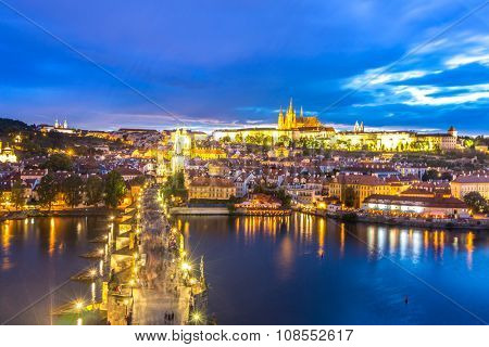 Pargue at dusk, view of the Lesser Bridge Tower of Charles Bridge (Karluv Most) and Prague Castle, Czech Republic.