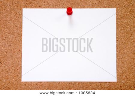 Blank Paper Stuck To A Notice Board, Ready For Your Message.