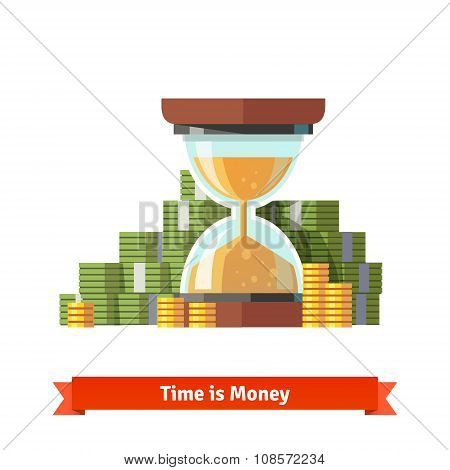 Hourglass in a pile of stacked dollar and coin