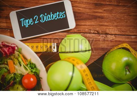 The word type 2 diabetes against phone on healthy persons desk